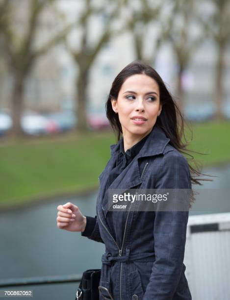 woman in park, worried - stalker person stock photos and pictures
