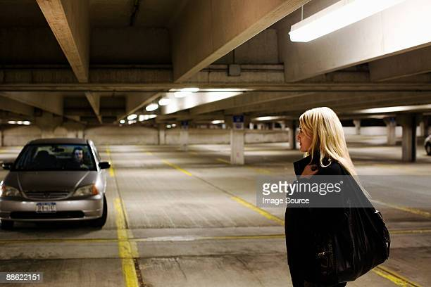 woman in parking lot - ominous stock pictures, royalty-free photos & images