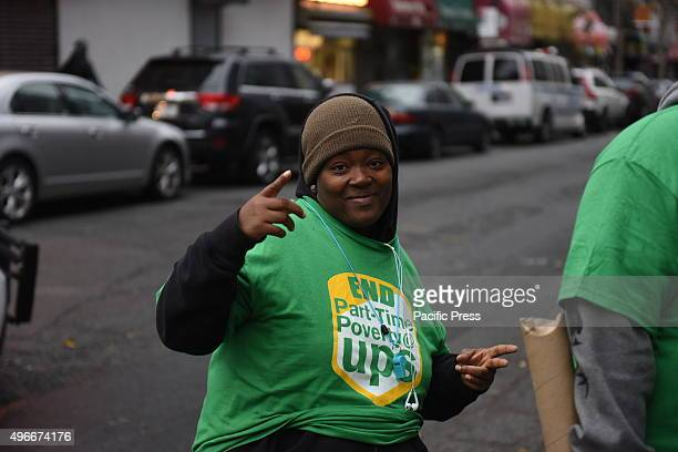 Woman in part time UPS worker tee shirt Fight for Fifteen's national day of action began with a walkout of fast food employees and a rally in...