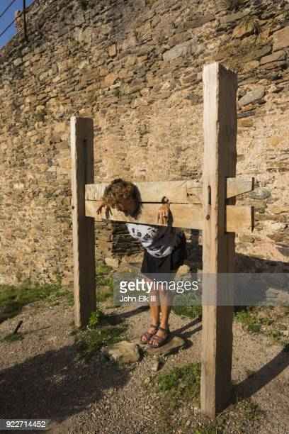 woman in penstock - punishment stocks stock pictures, royalty-free photos & images