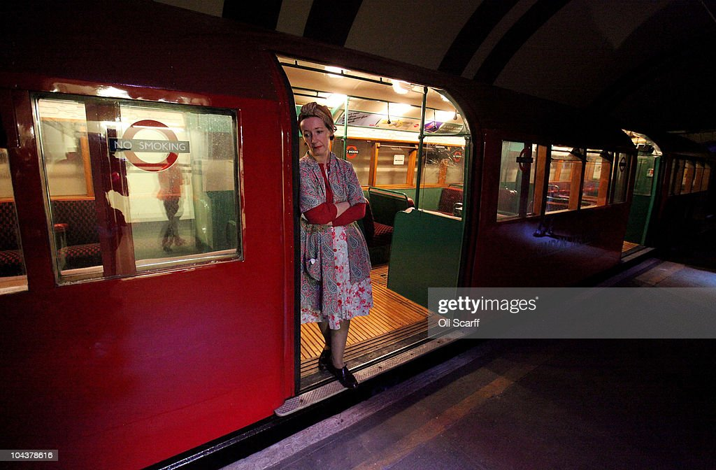 A Woman In Period Costume Looks Out From A 1930S Tube -7778