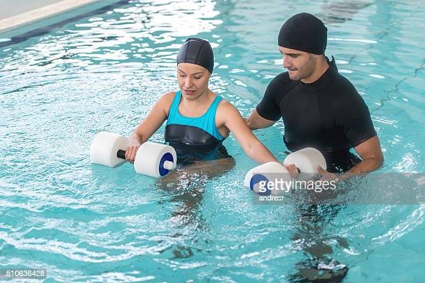 Woman in physical therapy in the water