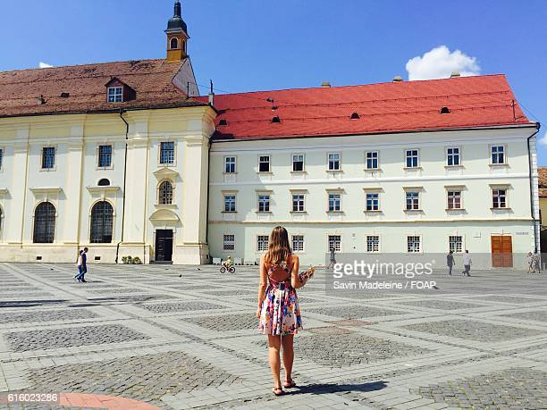 woman in piata mare at sibiu, romania - sibiu stock photos and pictures