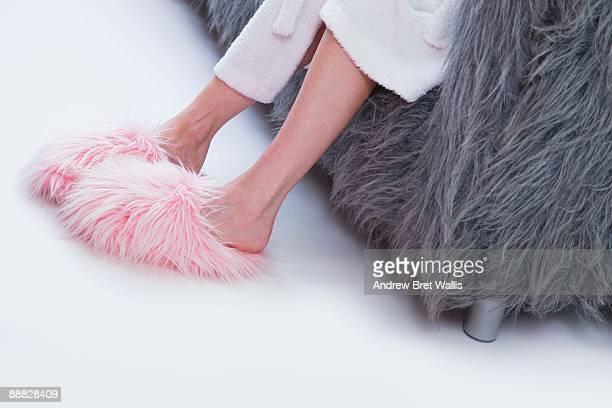 woman in pink furry slippers - hairy woman stock photos and pictures