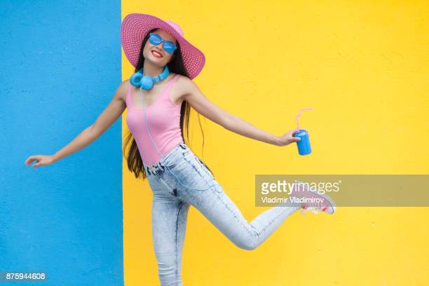 woman in pink outfit holding blue can and dancing - pink pants stock pictures, royalty-free photos & images