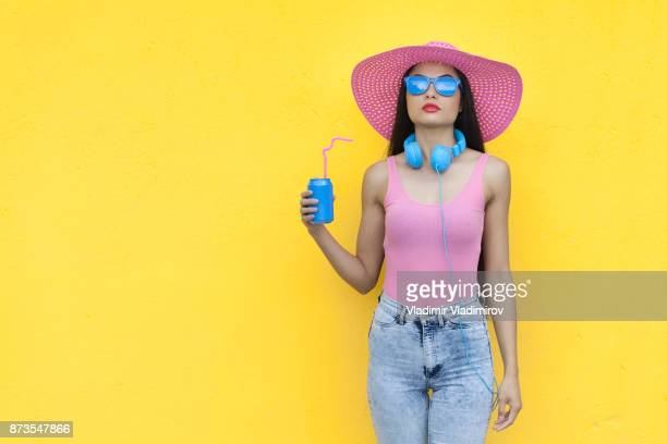 woman in pink outfit holding blue can - yellow hat stock pictures, royalty-free photos & images