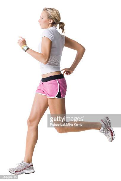 woman in pink running shorts