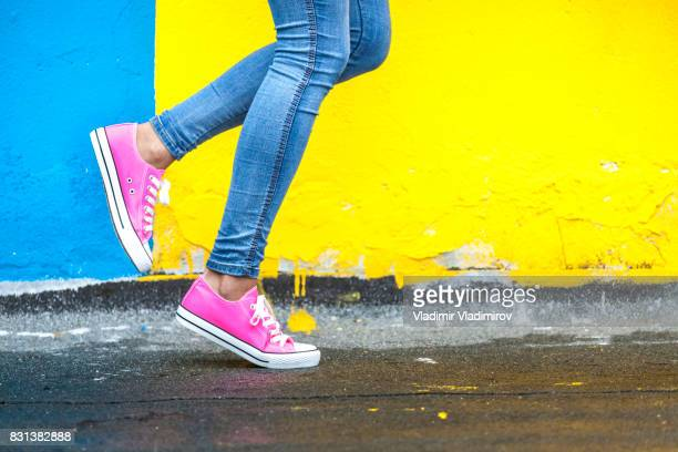woman in pink sneakers - multi colored stock pictures, royalty-free photos & images
