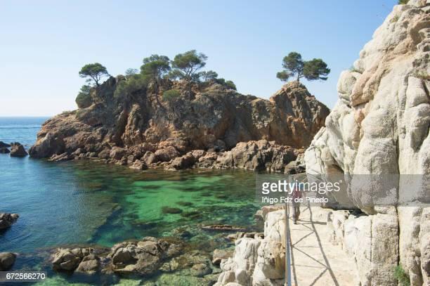 a woman in platja cap roig- sant antoni de calonge-costa brava- catalonia -spain - gerona province stock photos and pictures