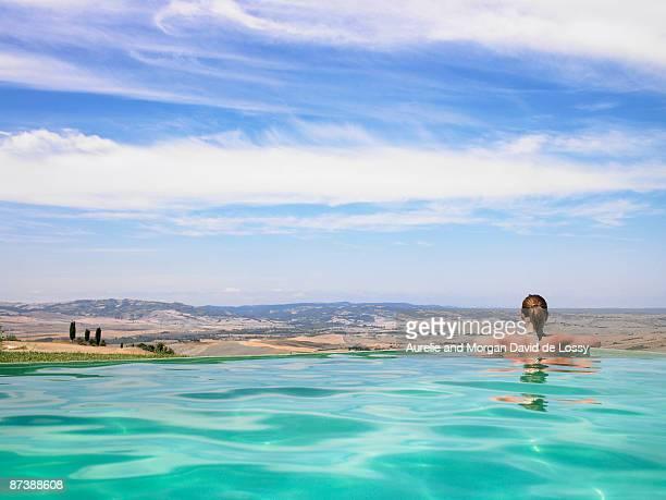 Woman in pool admiring view