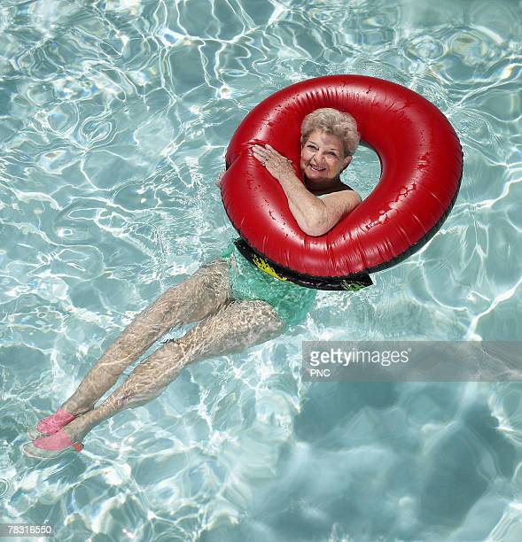 Woman in pool floating in inner tube