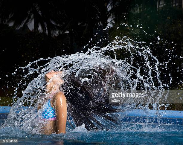 Woman in pool , head  coming out of water, night