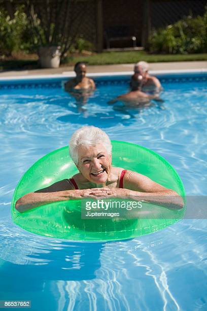 Woman in pool with inner tube