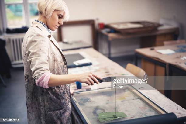 woman in printing workshop preparing colors - etching stock pictures, royalty-free photos & images