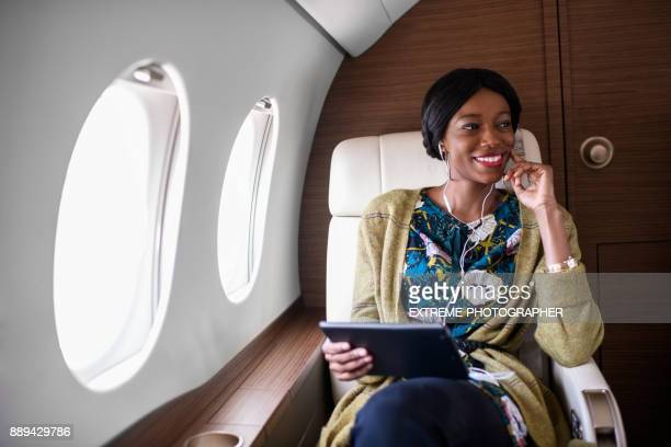 woman in private jet airplane - wealth stock pictures, royalty-free photos & images