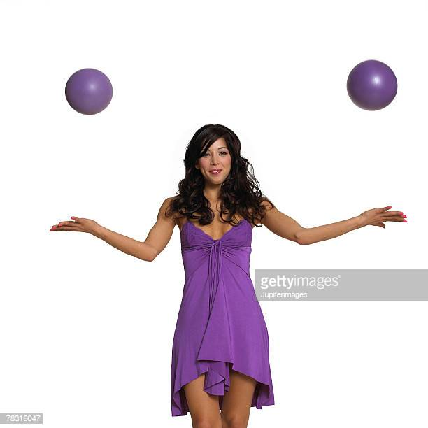 Woman in Purple Dress with Exercise Balls