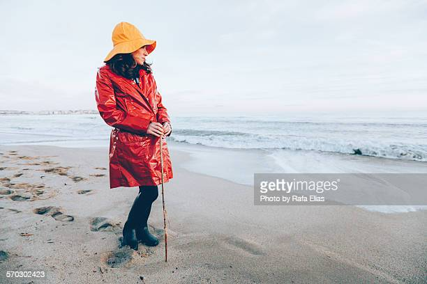 Woman in rainclothes on the beach