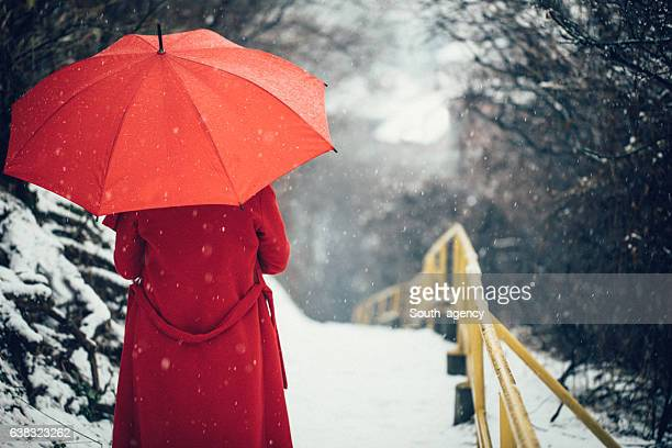 woman in red coat - red coat stock pictures, royalty-free photos & images