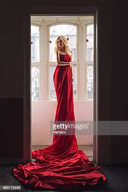 woman in red dress - satin dress stock photos and pictures