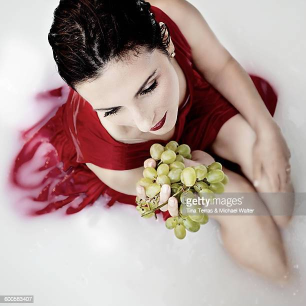Woman in red dress. White background.