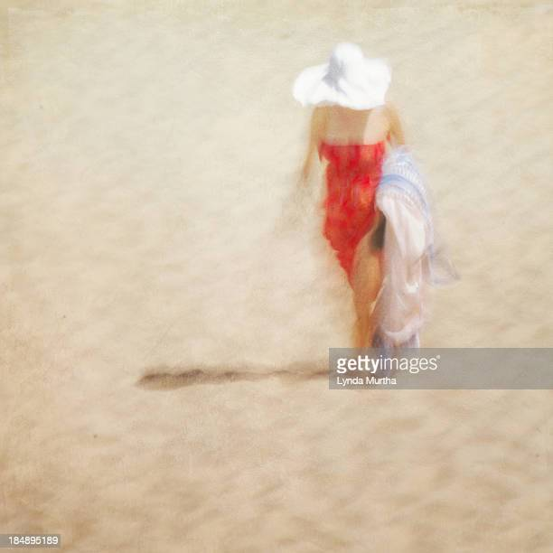 woman in red dress, white hat, on beach - chatham new york state stock pictures, royalty-free photos & images