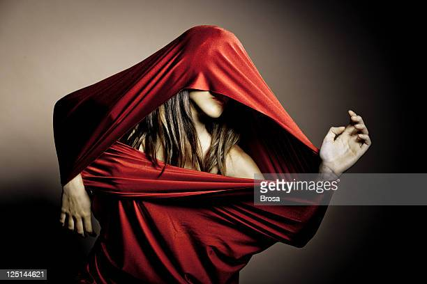 Woman in red fabric
