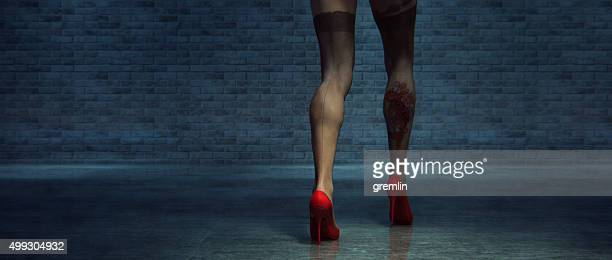 woman in red high heels walking on the street - women in stockings and high heels stock photos and pictures