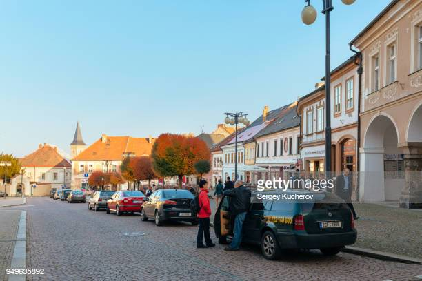 Kutna Hora, Czech Republic - Oct 22, 2013: A woman in red jacket is talking to the taxi driver.