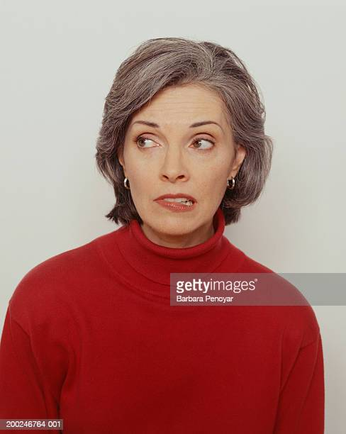 woman in red jumper, (portrait) - biting lip stock pictures, royalty-free photos & images