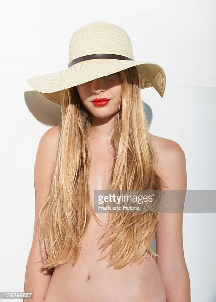 Woman in red lipstick wearing straw hat