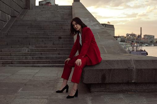 Woman in red pantsuit  walking in the city - gettyimageskorea