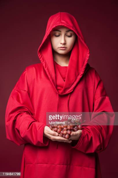 woman in red robe with grapes - ceremonial robe stock pictures, royalty-free photos & images