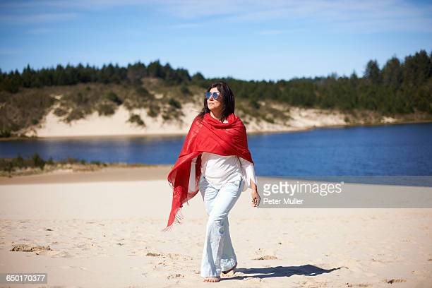woman in red shawl enjoying beach - shawl stock photos and pictures