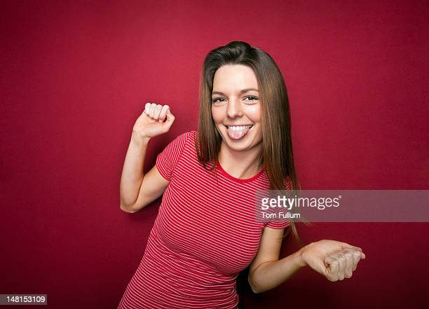 woman in red stripes sticking her tongue out - woman long tongue stock photos and pictures