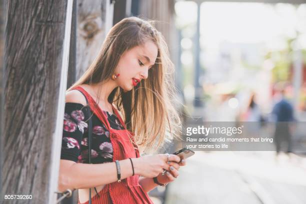Woman in red using smart phone