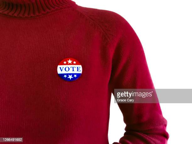 """woman in red wears """"vote"""" sticker - republican party stock pictures, royalty-free photos & images"""