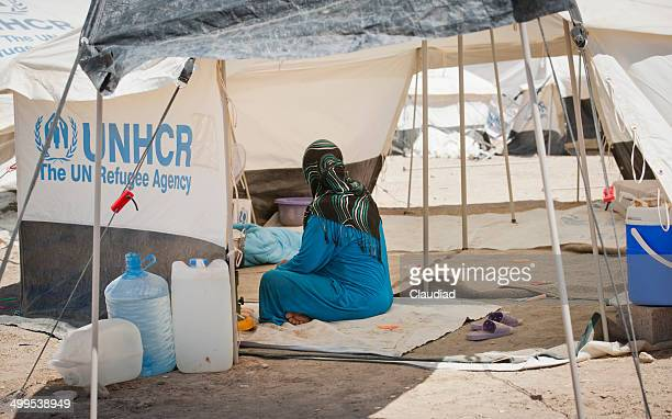 woman in refugee camp - humanitarian aid stock pictures, royalty-free photos & images