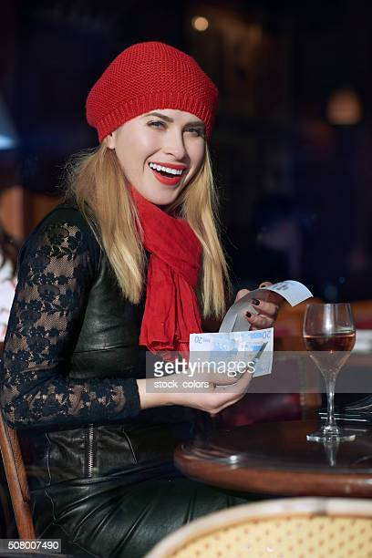 woman in restaurant paying the bill