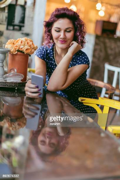 Woman in restaurant text messaging