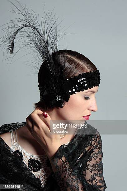 woman in retrow look of 1920s with feather hair band