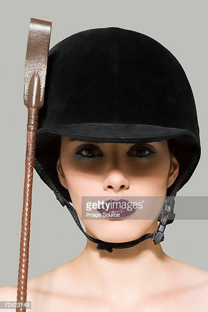woman in riding gear - riding crop stock photos and pictures