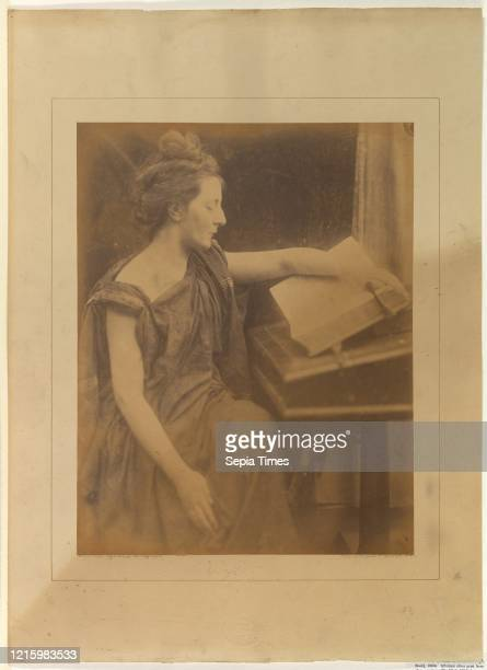 Woman in Robes Reading a Book. 1870. Albumen silver print from glass negative. 35.1 x 27.3 cm . Photographs. Julia Margaret Cameron .