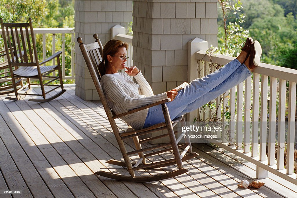 Woman In Rocking Chair On Porch Stock Photo Getty Images