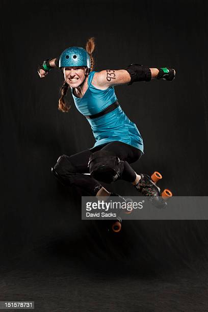 Woman in roller skates jumping