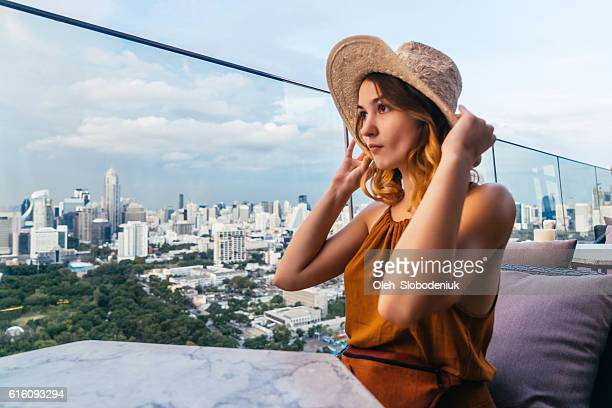 Woman in rooftop bar