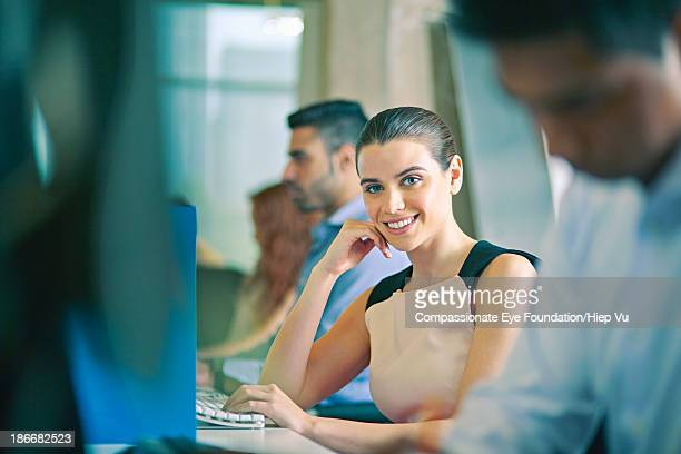 woman in row of office workers, smiling - lebanese ethnicity stock photos and pictures