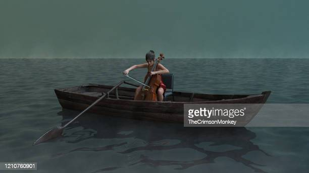 woman in rowboat playing cello - calm before the storm stock pictures, royalty-free photos & images