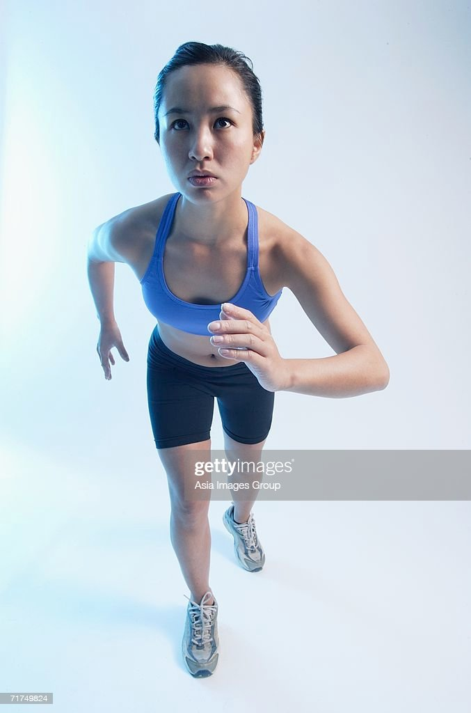 woman in running position facing forward stock photo getty images