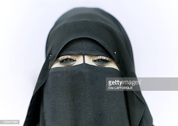 Woman in Salalah Oman on December 23 2009 Kohl a dark powder used as an eyeliner made mainly from frankincense or the roots of the arvea jevanica is...
