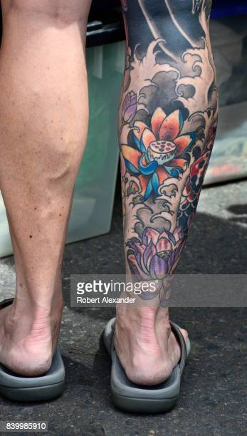A woman in Santa Fe New Mexico has a leg tattoo depicting lotus flowers To many the lotus is used to represent divine beauty and purity while the...